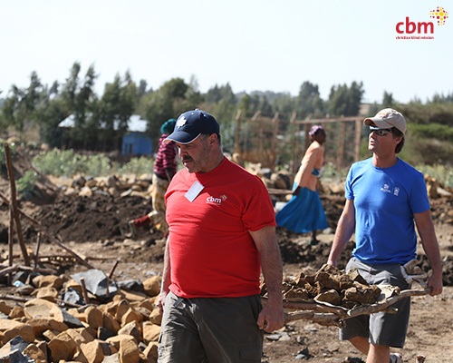 Tony and Ian hauling rock to prepare a foundation