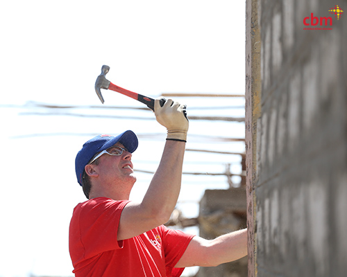 Brian Hatchel prepares a support column on one of the homes